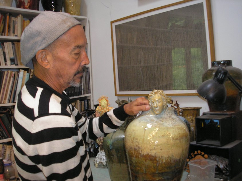 Yamaoka showing a vase inspired by Greek mythology