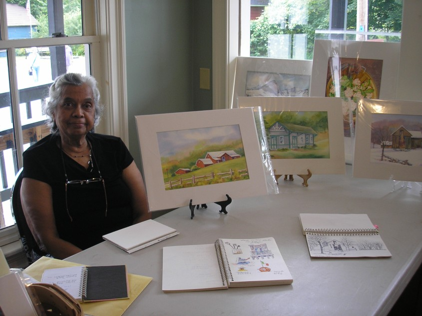 Oneida Hammond with her watercolors and sketchbooks