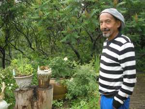 Artist Peter Yamaoka in his garden