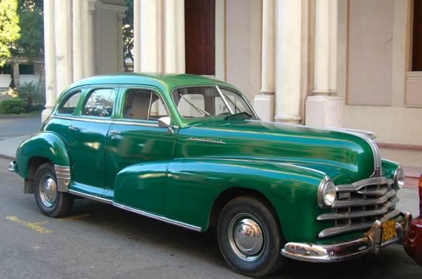 Vintage car in Cuba by John Lenihan